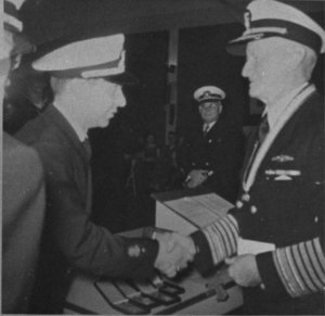 Fleet Admiral Nimitz presenting Sea Scout Charles Elliott the Quartermaster Award.